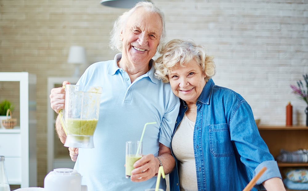 Happy elderly couple in kitchen